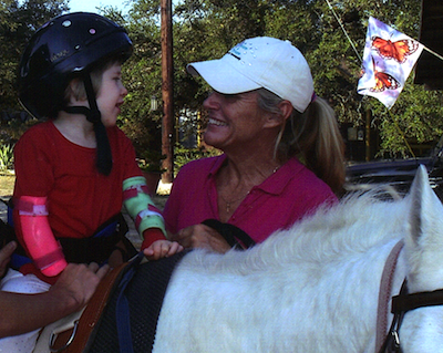 Online Scholarship Masters in Special Education Winner Brenda McCall with Horse and Rider