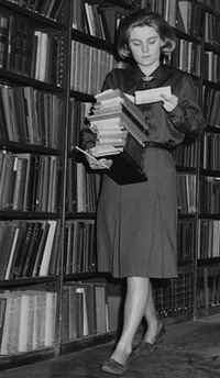 Vintage photo of woman examining books