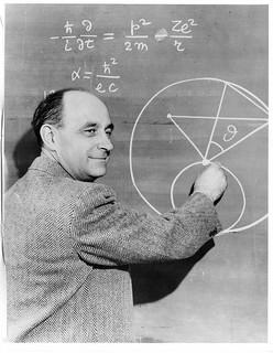 Enrico Fermi, 1938 Nobel Prize winner in physics, at a chalkboard