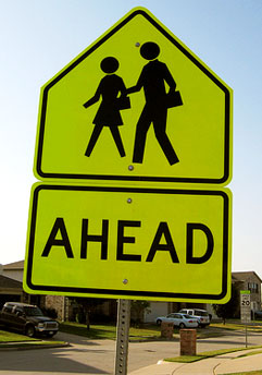 Going back to college - school ahead street sign