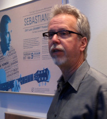 Gary Jones standing in front of poster