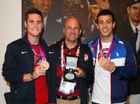 Diploma Mill Recipient Drew Johansen, Center, with Two Olympic Athletes