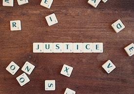 Online criminal justice degree grads enforce justice