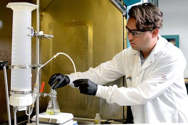 An online chemical engineering degree graduate in the lab