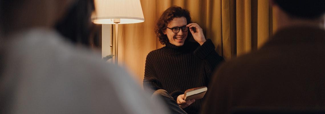 Online MFA creative writing grad at book reading